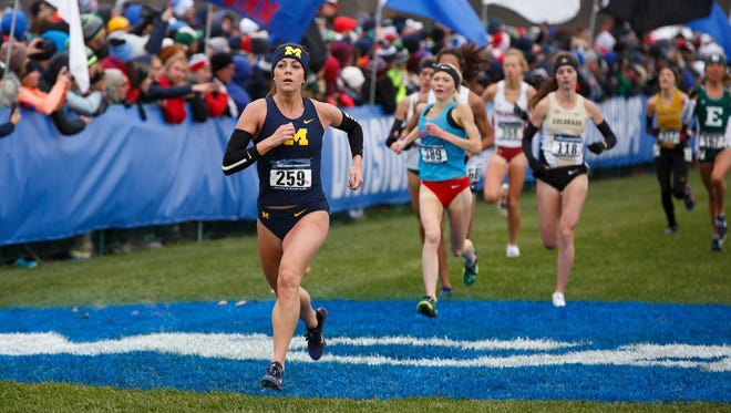 Avery Evenson of Hartland (259) runs to an 18th-place finish for Michigan in the NCAA cross country meet.