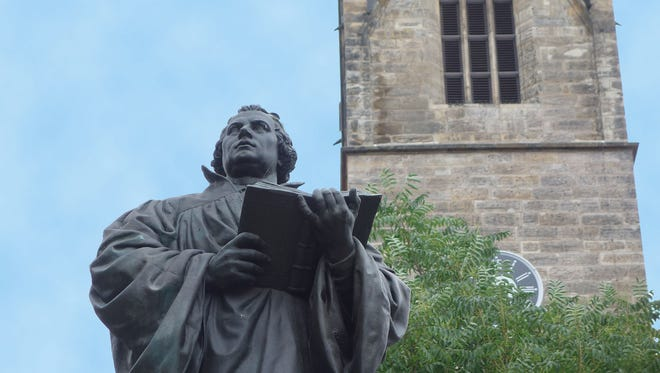 A statue of Martin Luther towers over the main shopping square of Erfurt, Germany, where he became a monk.