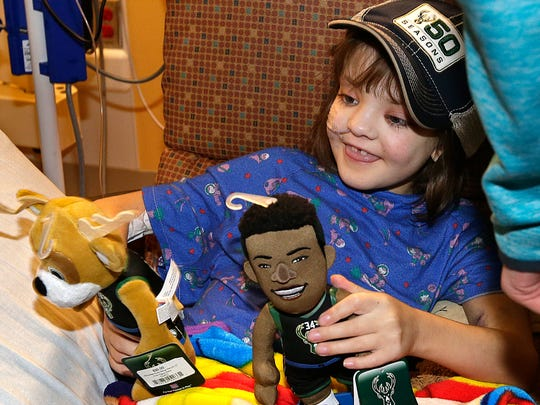 Bella Pape, a patient, smiles after meeting Milwaukee Bucks players and receiving gifts  at Childrens Hospital of Wisconsin.