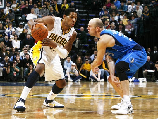Former Purdue star Brian Cardinal of the Dallas Mavericks faces off against Indiana Pacers forward Danny Granger.