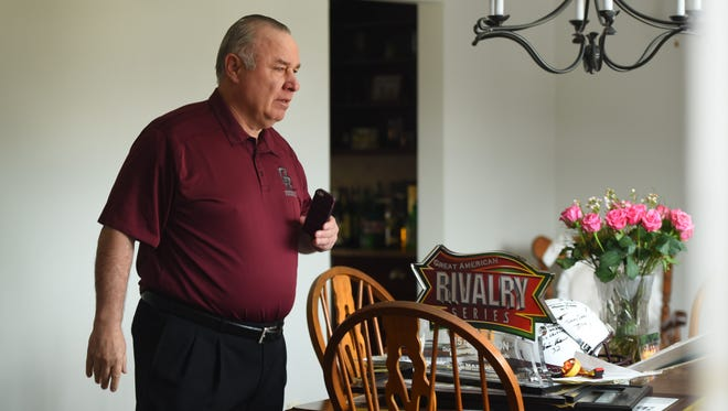 Former Don Bosco coach Greg Toal with his memorabilia and items on the table that were brought by a group of current  Don Bosco Prep football players to his home on Sunday morning as a show of support for their coach, who they feel was wrongly forced to resign by school officials.