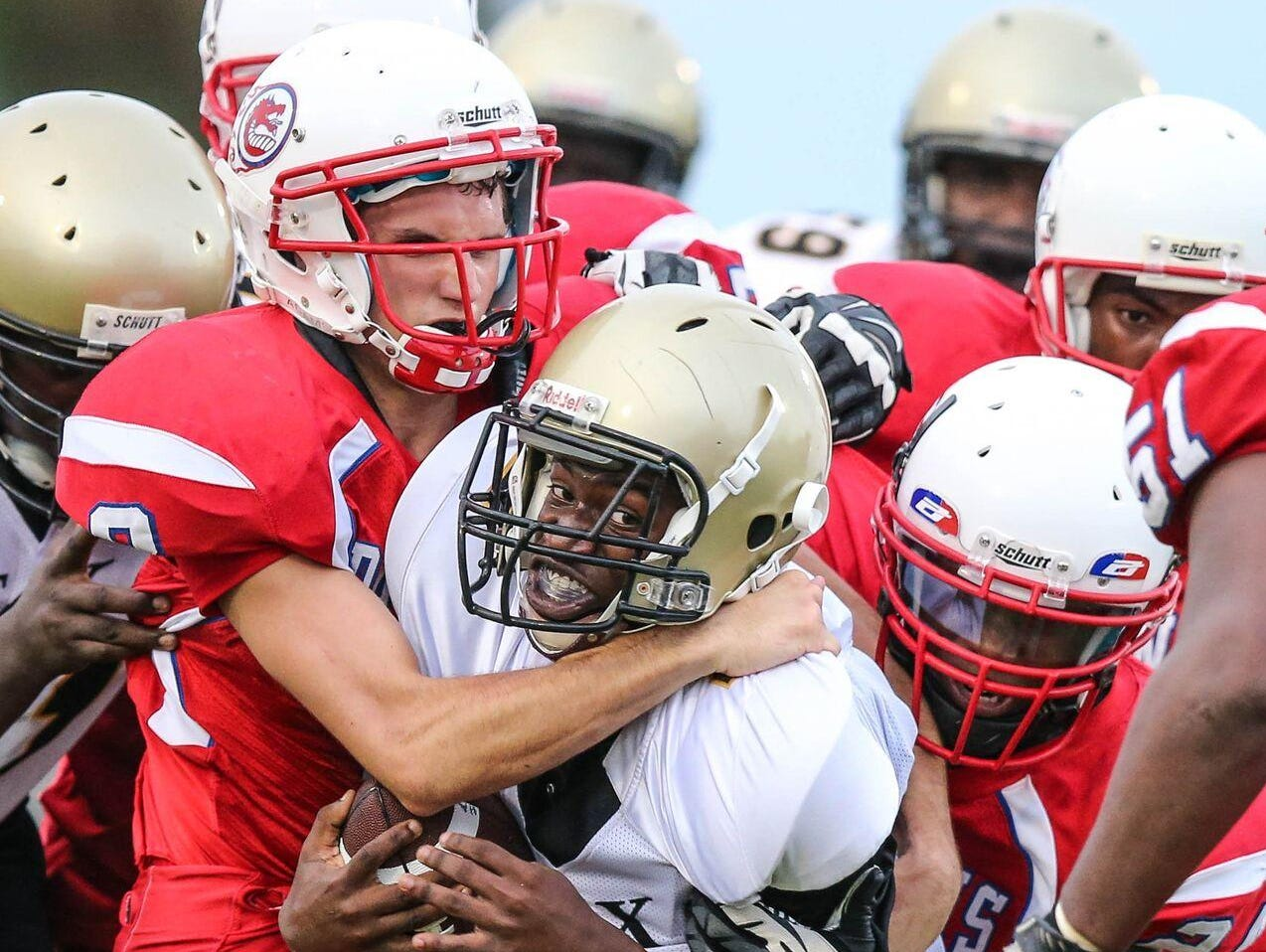 FSDB football player Tyler Ames gets in on a gang tackle during a game against Halifax Academy early in the 2015 season. The Dragons completed their 102nd season of football two weeks ago.