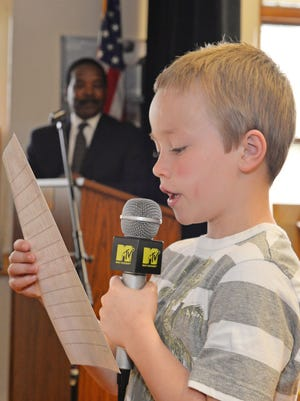 Kayden Phillips read his essays during a Wood School assembly in Millville. May 27, 2015.