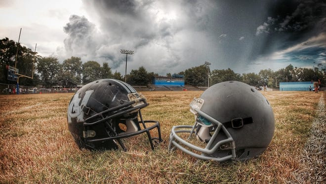 West Gadsden's and East Gadsden's helmets on historic Corry Field in Quincy, prior to a preseason game in 2015.