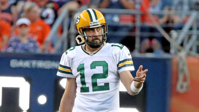 Green Bay Packers quarterback Aaron Rodgers (12) gestures during the game against the Denver Broncos Saturday, August 26, 2017 at Sports Authority Field at Mile High.