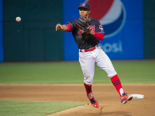 Cleveland Indians shortstop Francisco Lindor throws out Seattle Mariners Luis Sardines during the seventh inning of a baseball game, in Cleveland, Wednesday, April 20, 2016. (AP Photo/Phil Long)