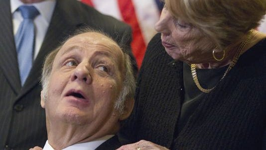 James Brady, who was left paralyzed in the attack, looks at his wife, Sarah Brady, during a news conference on Capitol Hill in Washington marking the 30th anniversary of the shooting. Brady died at age 73.