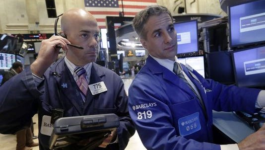 Traders work on the floor of the NYSE.