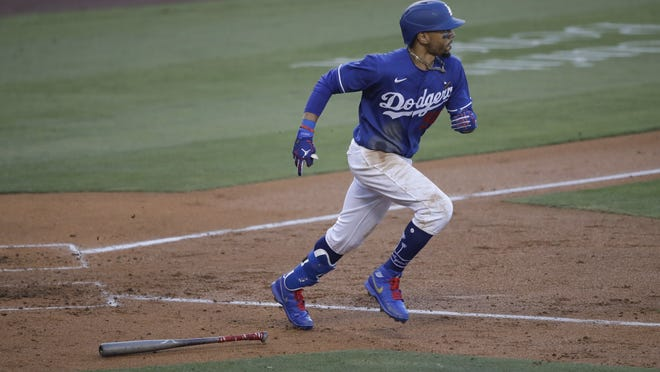 Dodgers outfielder Mookie Betts lines out to center field during the fourth inning of an exhibition baseball game against the Arizona Diamondbacks Sunday, July 19, 2020, in Los Angeles. Betts agreed to a 12 year, $365 million extension with Los Angeles on Wednesday.