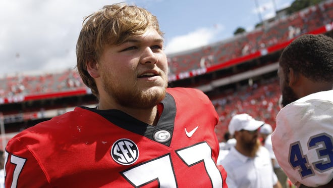 Georgia offensive lineman Cade Mays (77) walks off the field after an NCAA college football game between Georgia and Middle Tennessee at Sanford Stadium in Athens, GA. Saturday, Sept. 15, 2018. Georgia won 49-7.