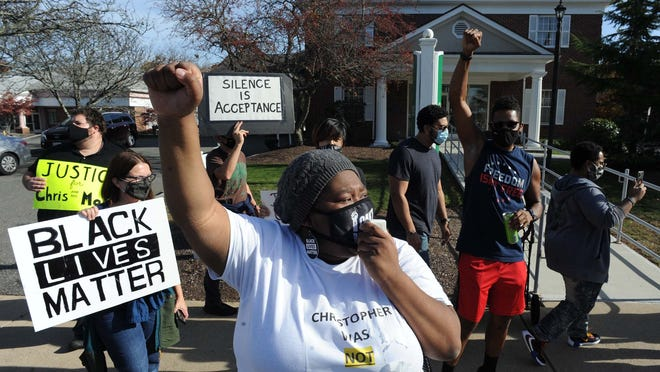 Protester Tiffany Adams during a protest at the police station and Citizens Bank in Randolph about the ongoing unrest over a police cruiser that hit Christopher Divens in August, on Saturday, Nov. 7, 2020.