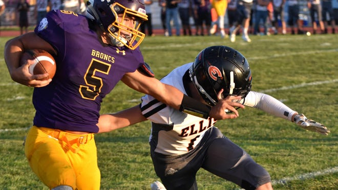 Lakin's Kade Lovelady gains extra yardage off a pass reception, past an Ellis defender, Sept. 25 at Lakin. The Broncs defeated Southwestern Heights on the road Friday at Kismet.
