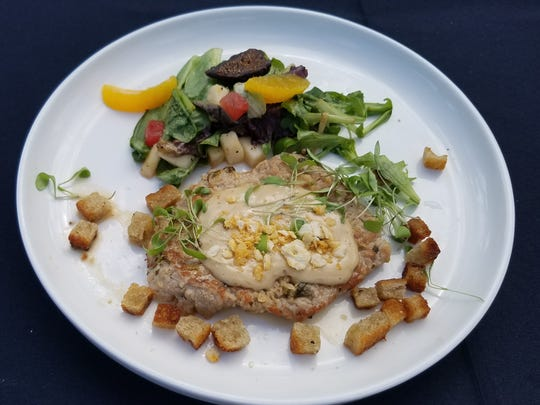 On day one of the Stuart Chopped competition, Chef Aldo Ramirez prepared pork loin marinated in pureed sauerkraut and lime, rye croutons and a citrus salad with apples and figs.
