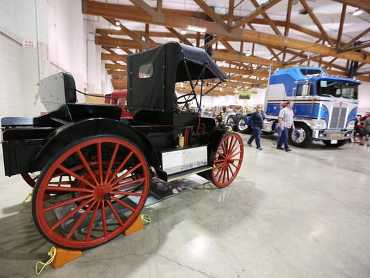 A 1910 International Auto-Wagon owned and restored by the B.C. Pioneer Truck Society on display during the American Truck Historical Society National Convention and Truck Show on Saturday, May 28, 2016, at the Oregon State Fairgrounds.