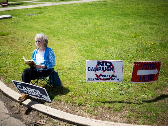 Kathryn Smith sits by the polling place at McCants Middle School, encouraging passersby to vote in the SC senate runoff election on Tuesday, April 25, 2017 in Anderson.