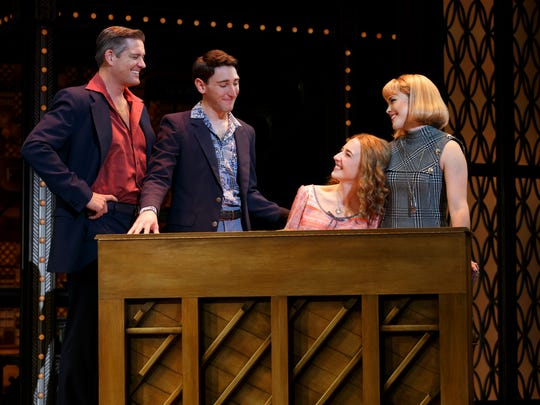 "Julia Knitel (seated at piano) portrays the title figure   in ""Beautiful - The Carole King Musical."""