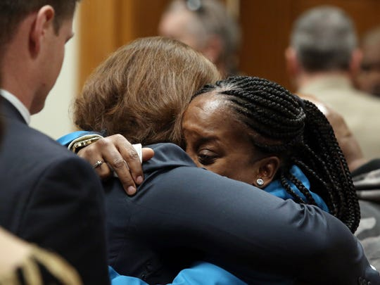 "Katrina Johnson hugs Des Moines County Attorney Amy Beavers after the jury returned a guilty verdict in Jorge ""Lumni"" Sanders-Galvez's first-degree murder trial, Friday Nov. 3, 2017 at the South Lee County Courthouse in Keokuk, Iowa. Sanders-Galvez was one of two men accused of killing Johnson's son Kedarie Johnson, 16, of Burlington, Iowa."