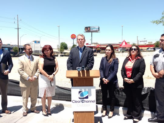 V. J. Smith, president of Clear Channel Outdoor Americas-El Paso, center, speaks about National Missing Persons Day on Wednesday. El Pasoan Lupe Amaya, whose daughter has been missing for 20 years, is second from right.