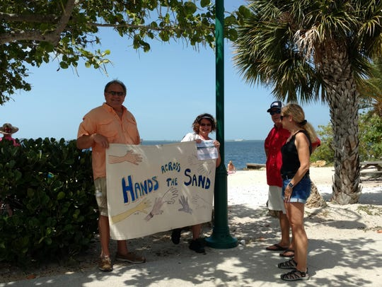 While holding a sign at Cape Coral Yacht Club in honor