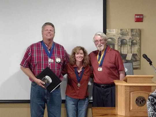 Lyndel Cook and Angela Nicolini receive the Kiwanis Club of Greater Abilene's C.T. Bush Award, presented by Richard Melton.