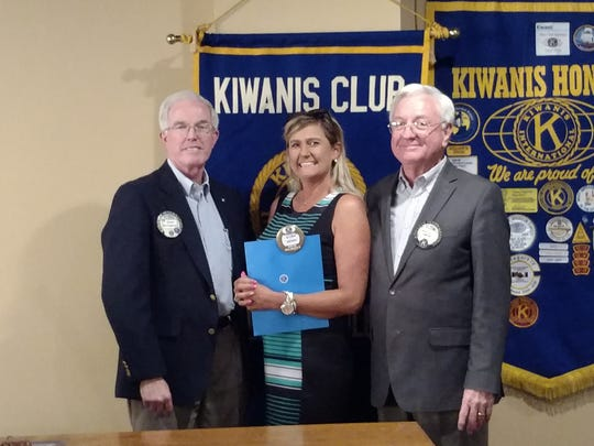 A'lisa Denny is welcomed to the Kiwanis Club of Greater Abilene by club president David McCaghren and her sponsor, Bruce Campbell.