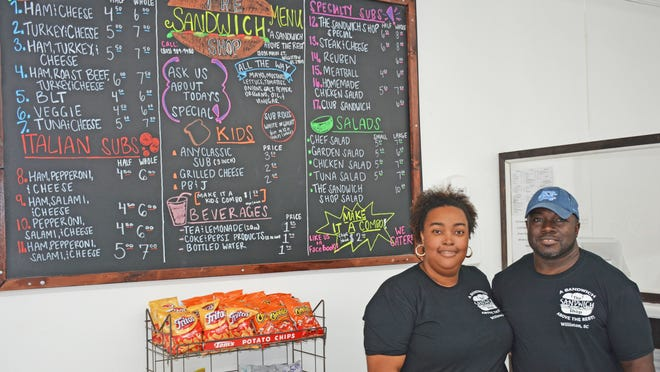 Starreatha and Russell Perry are the owners of The Sandwich Shop in downtown Williston. The menu board and logo were created by their friend, Fantasia Chandler.