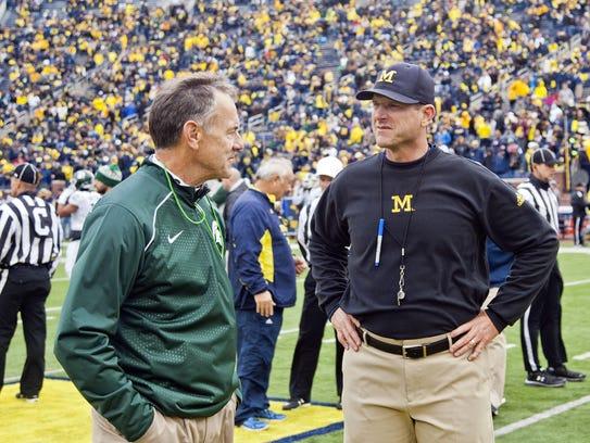 Mark Dantonio, left, and Michigan's Jim Harbaugh.