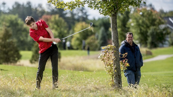 Metamora Redbird Tyler Lankston hits toward the green from the rough along the 13th fairway at Metamora Fields Thursday, October 1, 2020 in the Mid-Illini Conference golf tournament in Metamora.