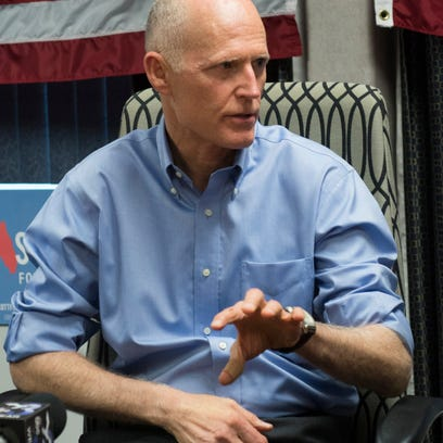 Gov. Rick Scott speaks with a group of small business