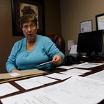 Kathy Meredith on Friday demonstrates how she sets up a sexual assault kit at Sexual Assault Services of Northwest New Mexico in Farmington.