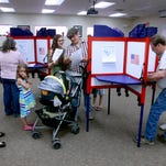 Voters fill in their ballots during the primary election Tuesday at the San Juan County Fire Operations Center in Aztec.