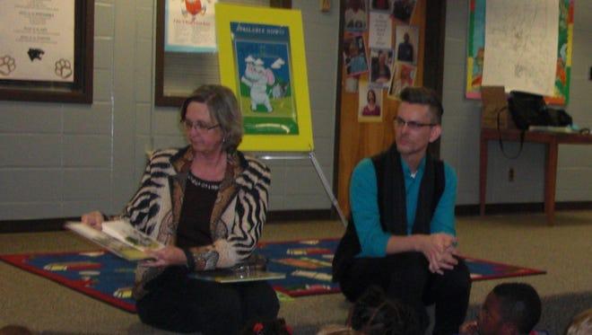 Lumberton Library manager Melinda Carli and author Andrew Fairchild read to kindergarteners at Lumberton Elementary.