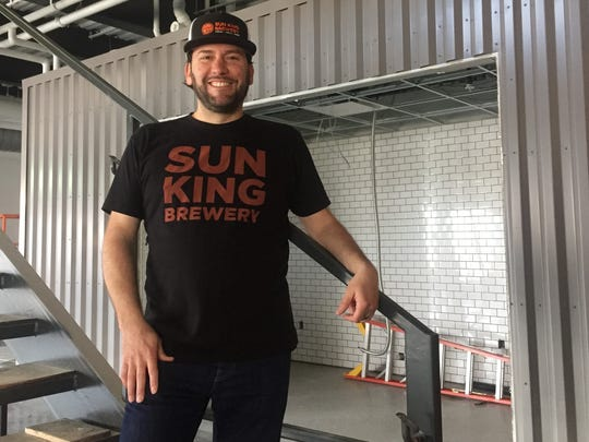 Sun King co-owner Clay Robinson stands in front of one of four food stalls that will create a food-hall-style atmopshere at Sun King distillery opening July 2 in Carmel.