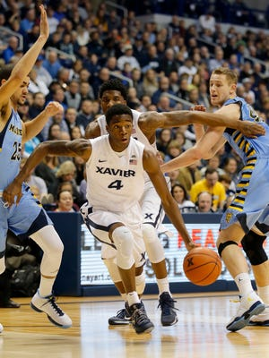 Xavier's Edmond Sumner drives to the hoop against Marquette during the first half at the Cintas Center Saturday, February 6, 2016.