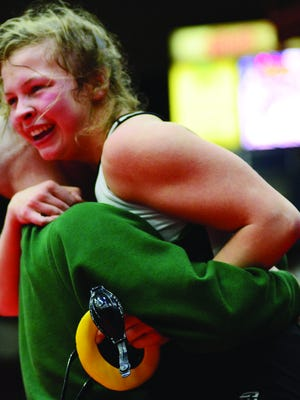Pratt's Liva Swift hugs her coach after defeating Mulvane's Kammie Schanz in the 143 weight-class at the Kansas State High School Activities Association, KSHSAA, Girl`s Wrestling Inaugural State Championship at the Tony's Pizza Events Center in Salina on Thursday, February 27, 2020.