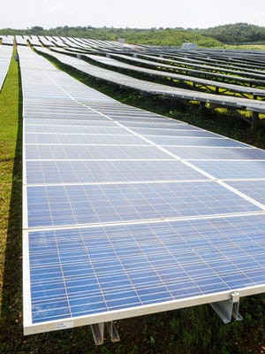 In this file photo, solar panels are shown at NRG Renew's Dandan Solar Project in Inarajan.