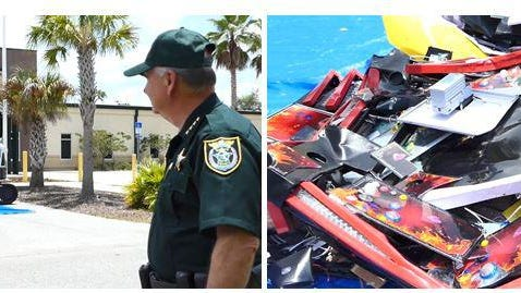 Flagler sheriff Rick Staly, left, helped crush five illegal gambling machines on-site at the former Sheriff's Office oprations center in Bunnell on July 14.