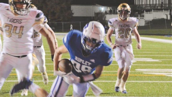 Junior Blake Cummings, No. 89, catches the pass for a Viking touchdown.