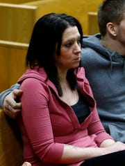 Kaytlin King listens to her ex-fiance Michael Speirs status hearing Thursday at the Marathon County Courthouse in Wausau.