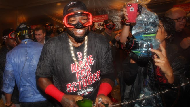 David Ortiz celebrates with teammates after clinching the AL East.