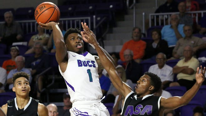 Nych Smith shoots during FSW's home game against ASA College.