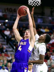 Dylan Jones of Waukee drives to the basket during the