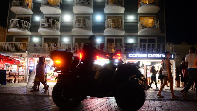 A police officer on a 4-Wheeler patrols the boardwalk during the first night of College Beach Weekend. After an incident last year the OCPD has placed a large presence on the boardwalk for added safety and security. Friday, July 21, 2017.