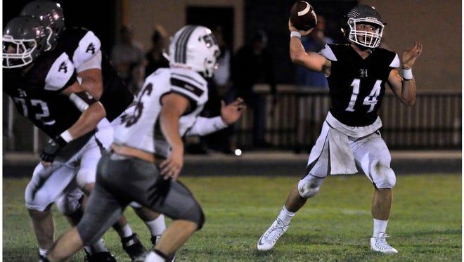 Hawley High School quarterback Quay Stokes throws a pass during Friday's game against Seymour High School Oct. 6, 2017. Hawley won, 28-0.
