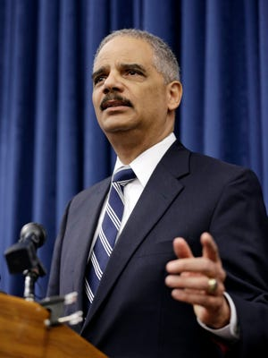 U. S. Attorney General Eric Holder speaks during a news-conference before a roundtable meeting Thursday, Dec. 4, 2014, in Cleveland.