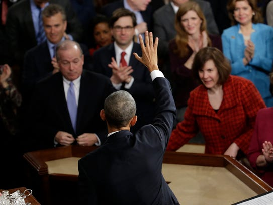 President Obama waves after giving his State of the