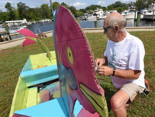 Jan Wier of Laurel adds the final touches to his cardboard
