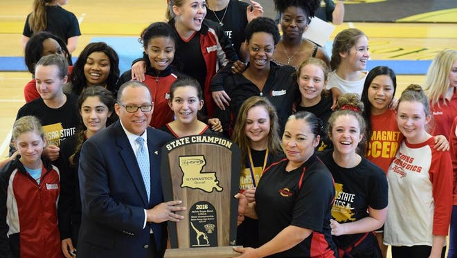 The Caddo Magnet girls gymnastics won the state title over the weekend.