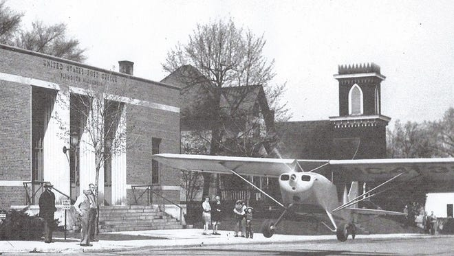 This Piper Cub was towed from Chaplin's Air Park and displayed on Main Street in front of the Plymouth Post Office. It was just a way to celebrate the 50th anniversary, planned by the Postmaster, Gus Schiereck. The plane was towed in by pilot, Norbert Langer, and rumor has it, the plane flew out. Sheboygan Press photo