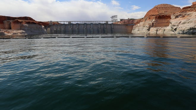 The water of the Colorado River reaches a depth of over 450 feet in Lake Powell as it backs up behind the Glen Canyon Dam May 18, 2013.